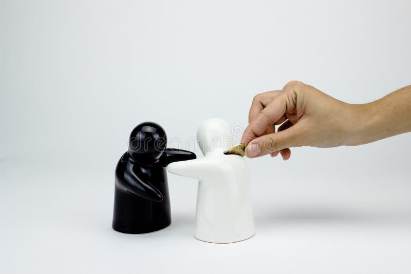 Ceramic penny bank. Ceramic penny bak figurines on white background royalty free stock photo