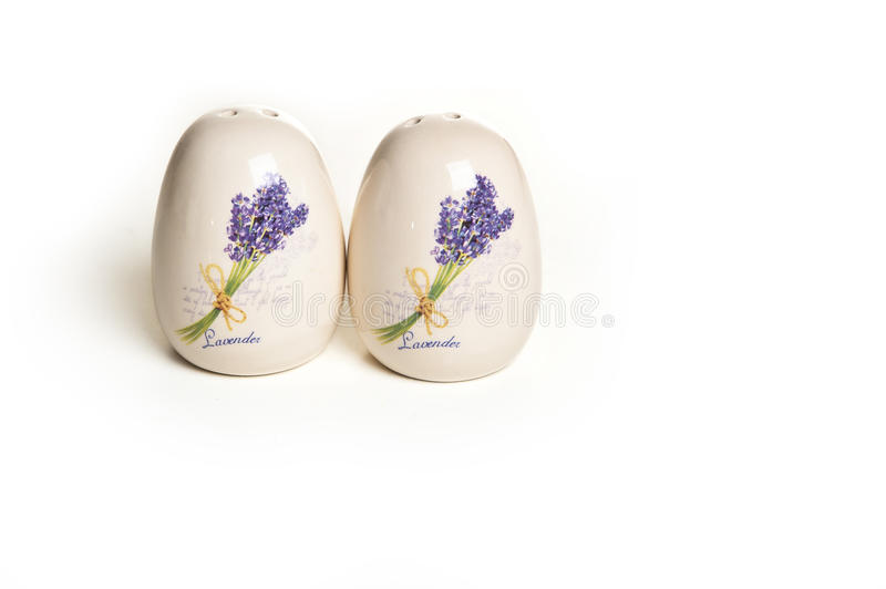 Ceramic pepper pot and salt cellar. With lavender print on a white background royalty free stock image