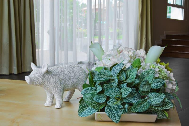 Ceramic. Pig ceramic doll in drawing room royalty free stock photos