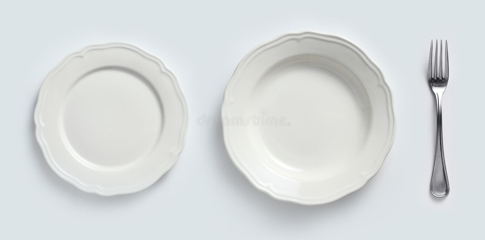 Ceramic plates & cutlery. White ceramic plates and cutlery stock photos