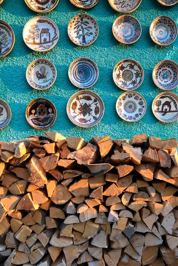 Ceramic plates and souvenirs. Romanian pottery on green wall stock images