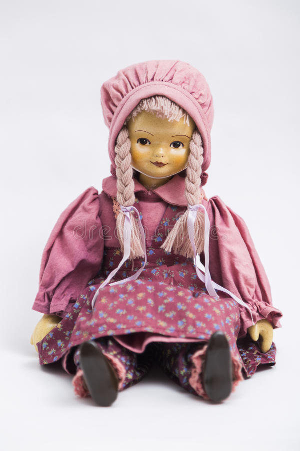 Ceramic porcelain handmade doll in pink vintage clothes stock photo