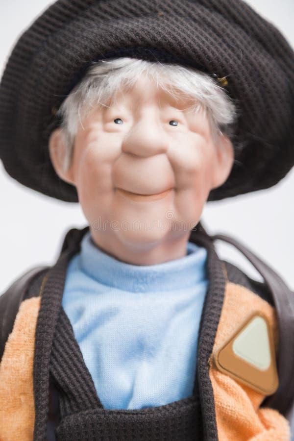 Ceramic porcelain handmade old doll of elderly fisherman royalty free stock image