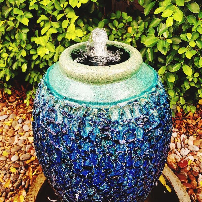 Ceramic pot at home garden. Decoration, gardening, vase, pottery, ourdoor, house, nature, spring, fountain, blue, design, art, creative, garden-arrangement royalty free stock image