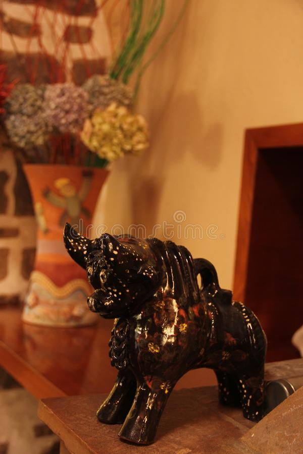 A ceramic Pucara Bull statue. Made to be placed on the roof for prosperity in Ollantaytambo, Peru royalty free stock images