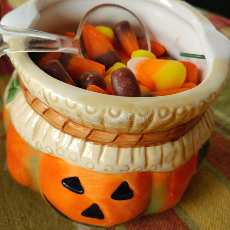 Ceramic Pumpkin Filled With Candy Corn royalty free stock photos