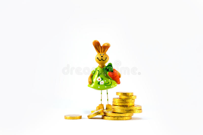 Ceramic Rabbit And Gold Coins. Stock Photo