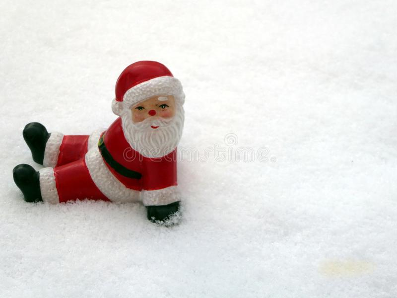 Ceramic santa claus on snow background. Lovely Merry Christmas and Happy New Year 2018 on snowfall background. stock photo