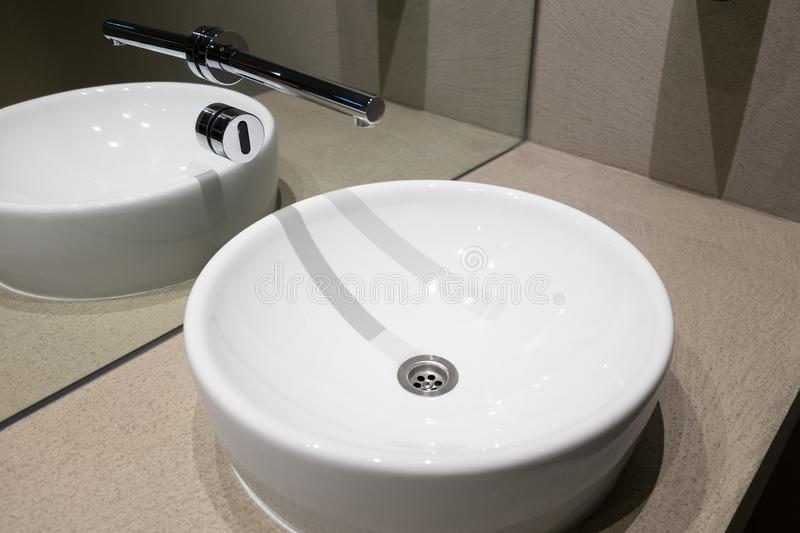 Ceramic sink with contactless sensor stock images