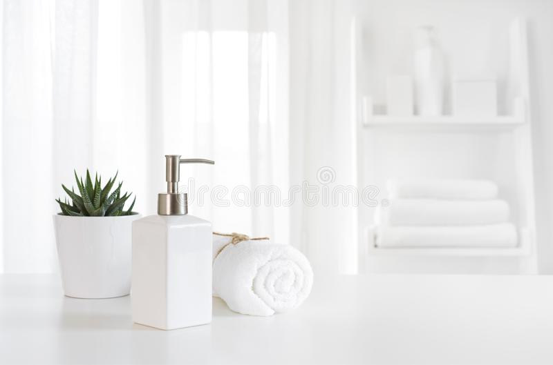 Ceramic soap, towel, copy space on blurred white spa background.  royalty free stock photography