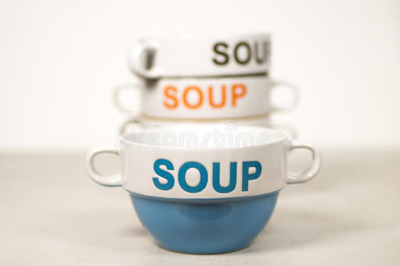 Ceramic Soup Bowls Stacked With Word SOUP On Them Blue in Front stock photos