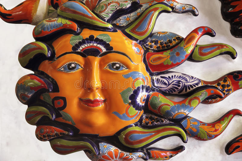 Ceramic Sun. Decorated with floral designs stock photo