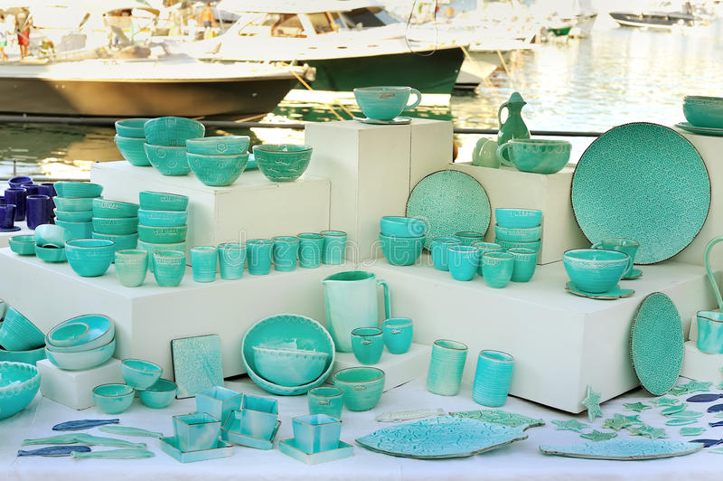 Ceramic tableware in Seastyle pottery painted celadon. Italian Ceramic tableware celadon painted in seastyle stock image