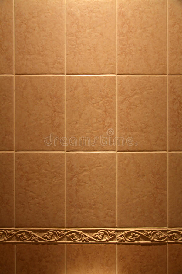 Ceramic tile. On a wall as a background royalty free stock photo