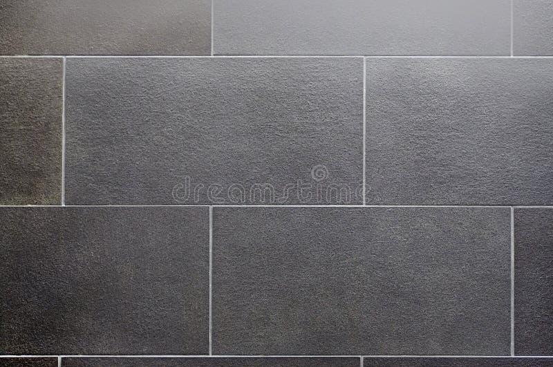 Ceramic tile, dark square seamless texture-gray, tile flooring. Ceramic tile, seamless texture square dark gray stock images