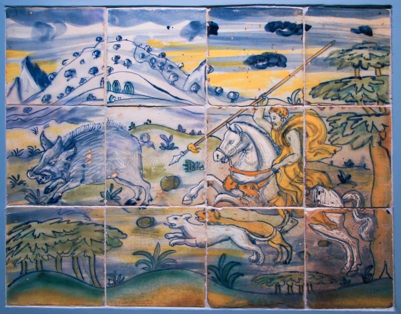Ceramic tile with hunting scene stock image