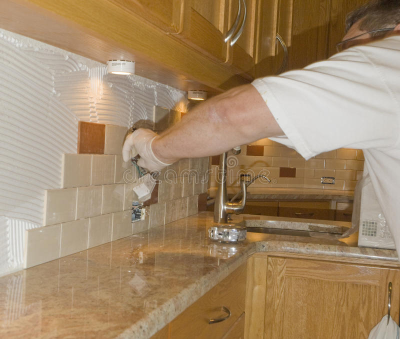 installing ceramic tile backsplash in kitchen ceramic tile installation on kitchen backsplash 12 stock photo image of electrical cement 8437