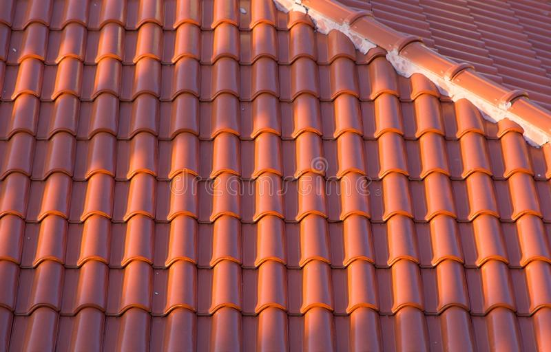 Ceramic tile roof. Classical ceramic tile roof built in Roman style with convex vertical stripes royalty free stock images