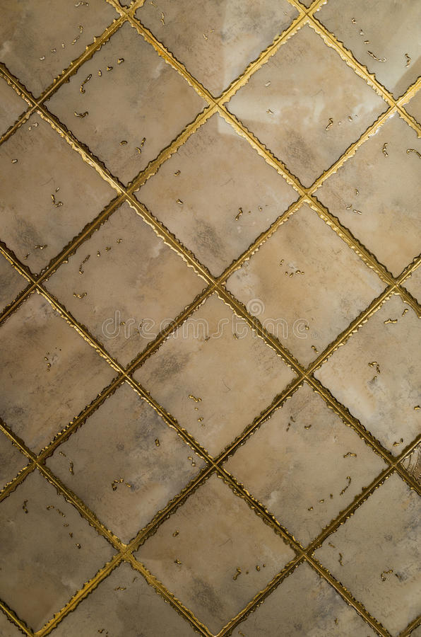 Ceramic tile surface. With gold thread vintage ceramic tile surface royalty free stock photo