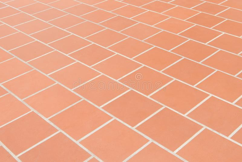 Ceramic tiled floor Red brick wall texture background. Ceramic tiled floor Red brick wall texture background stock photography