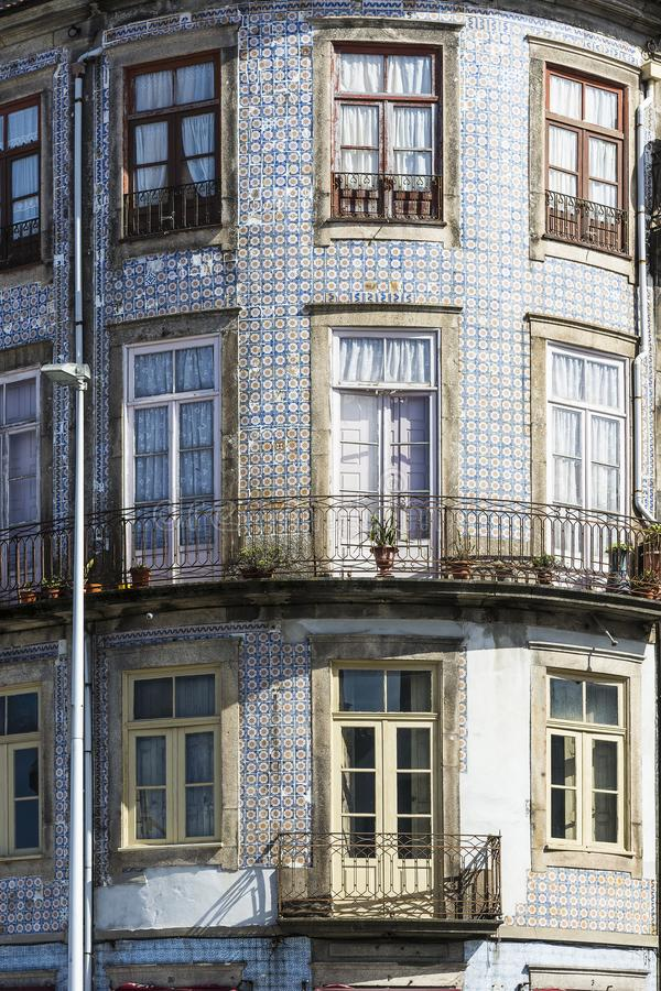 Ceramic tiles decorate a facade. Traditional Portuguese ceramic tiles of azulejo decorate a facade of the old house in the city of Porto stock photography