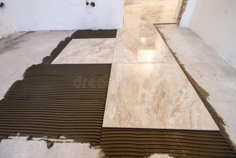 Ceramic tiles. Floor tiles installation. Home improvement, renovation - ceramic tile floor adhesive, mortar.  stock photos