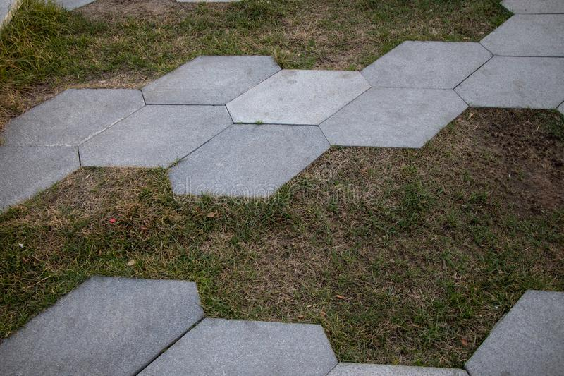 Ceramic tiles look very harmonious with grass stock images
