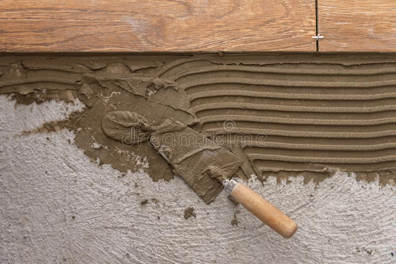 Ceramic tiles and tools for tiler. Floor tiles installation stock photography