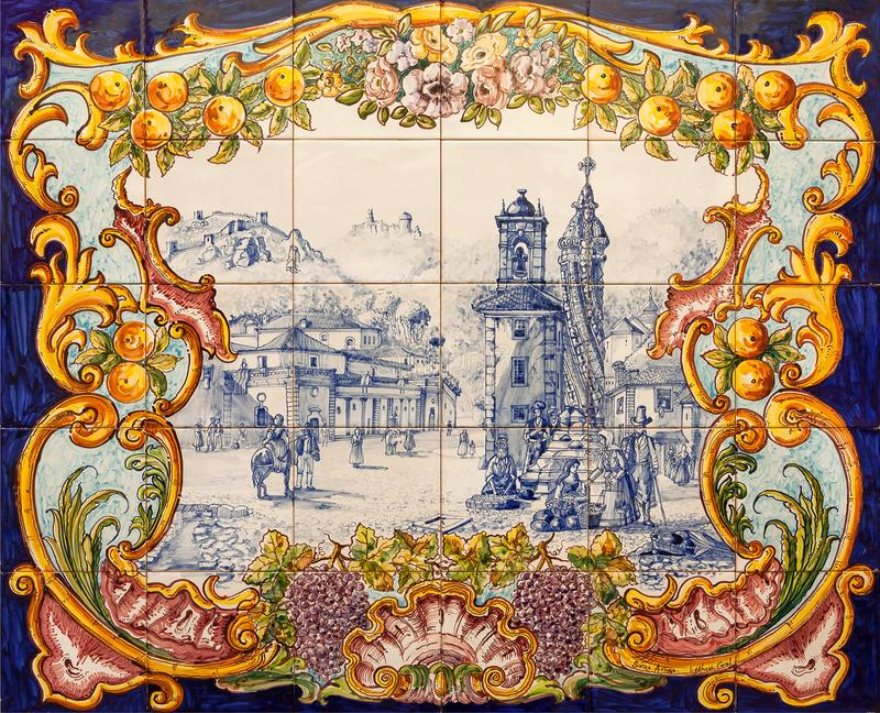 Ceramic tiles in vintage style of traditional azulejo on wall of historical city stock image