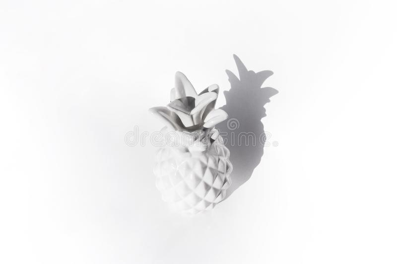 Ceramic white pineapple on a white background. bright shadow stock images
