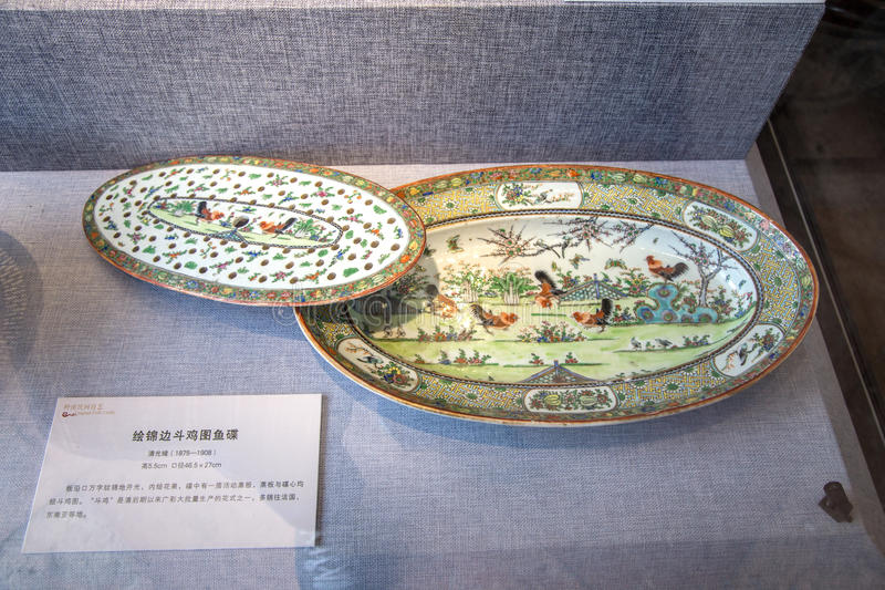 A ceramic work of art during the reign of Emperor Guangxu in the Qing Dynasty, painted with plates of roosters fighting. Chen Jia CI Tang and Chen Academy said royalty free stock photos