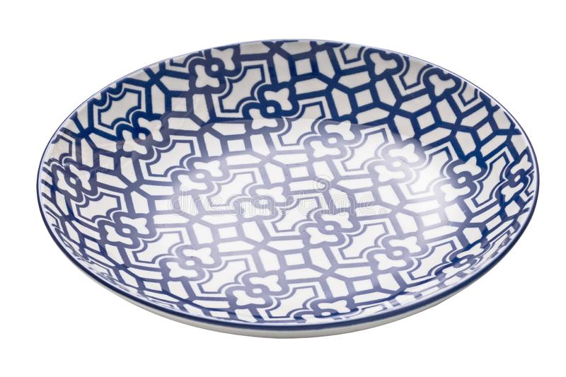 Ceramics decorative plates, Blue and white pottery plate isolated on white background with clipping path, Side view royalty free stock photo