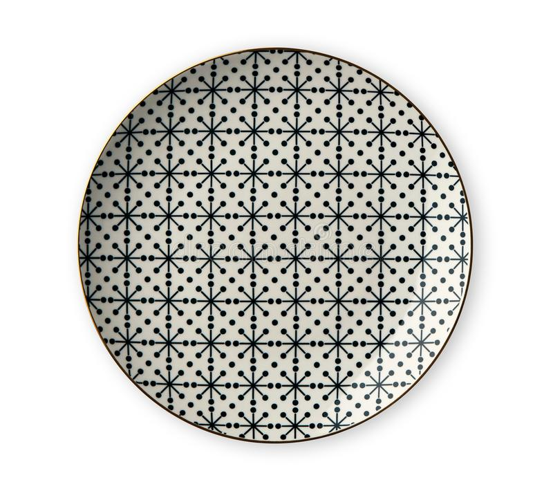 Ceramics decorative plates, Plate with geometric pattern and gold rim, View from above isolated on white background stock image