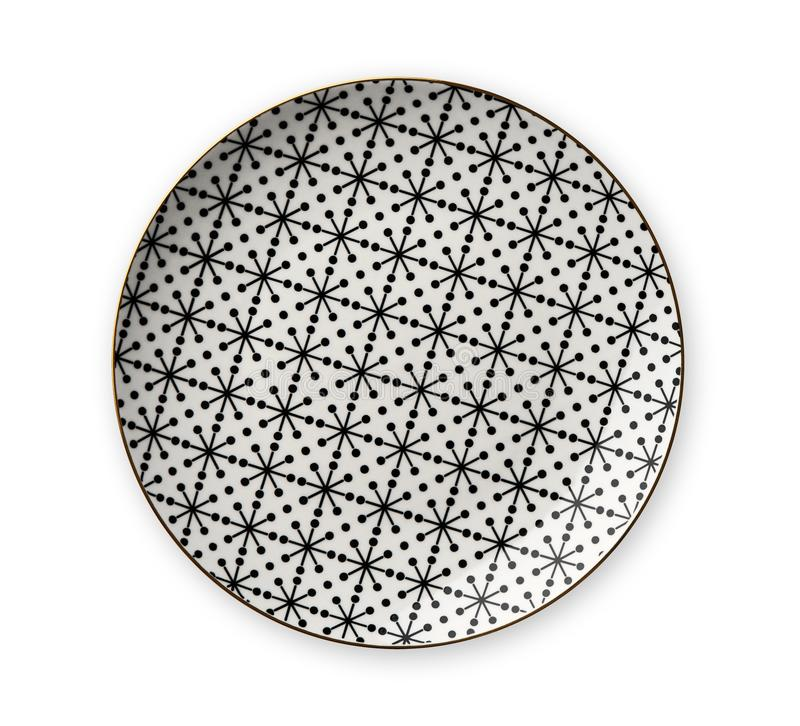 Ceramics decorative plates, Plate with geometric pattern and gold rim, View from above isolated on white background stock photos
