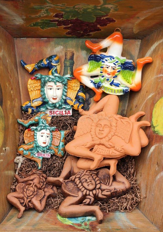 Ceramics depicting the trinacria, symbol of sicily. Some traditional glazed ceramics, depicting the trinacria, symbol of sicily, from erice, portrait cut stock photography