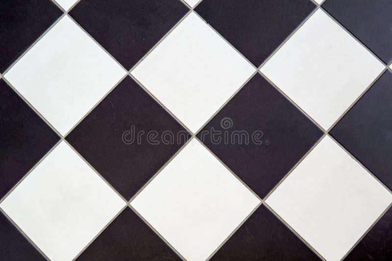 Ceramische zwart-witte vloertegel stock afbeelding