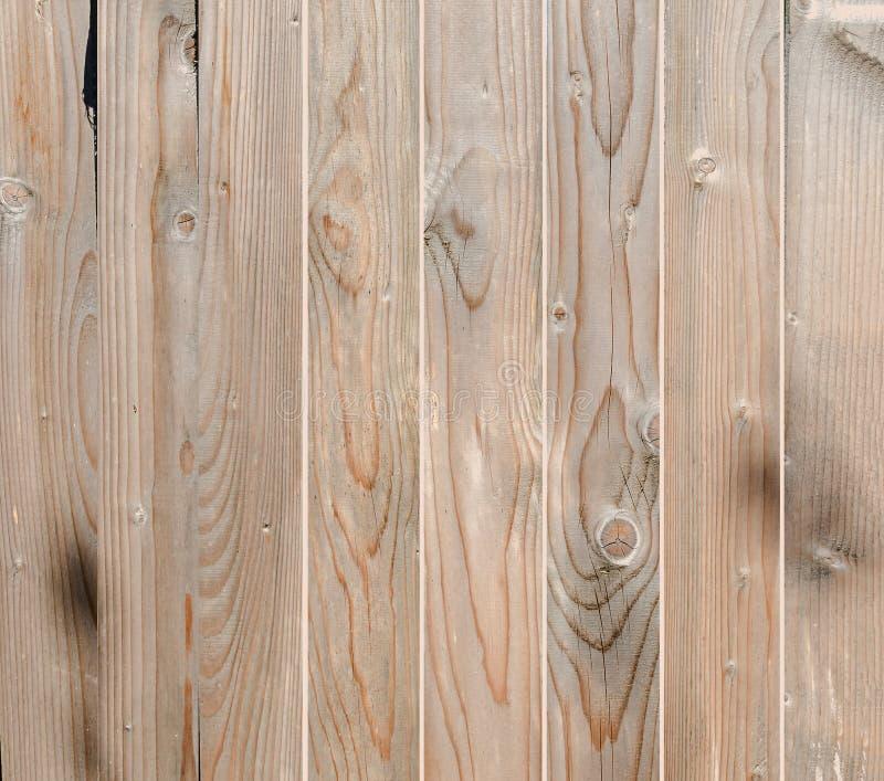 Cerca de madeira de Brown, fim acima, textura, fundo Madeira natural Barras verticais fotografia de stock royalty free