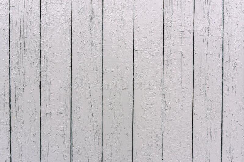 Cerca de madera blanca La superficie del ?rbol Tableros pintados en el color blanco Textura desigual Fondo de madera de la textur fotos de archivo libres de regalías