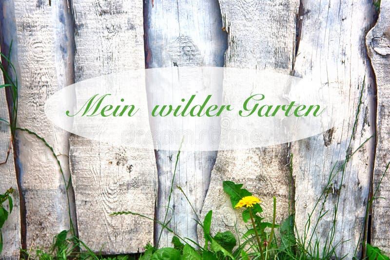 Cerca de madera con las palabras alemanas para mi jardín salvaje fotografía de archivo libre de regalías