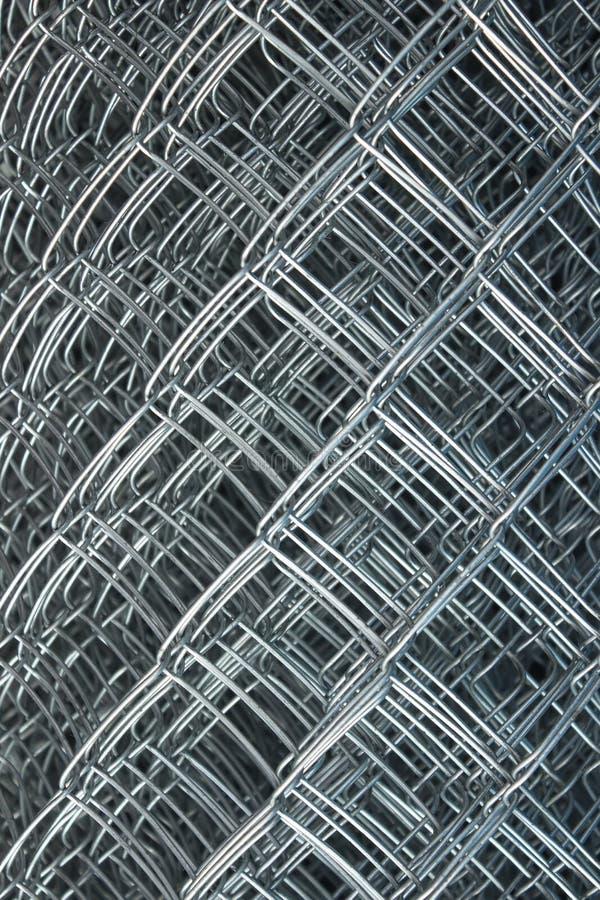 A cerca engrenada, rede de arame, rede de fio, rabitz, rolou o cerco foto de stock royalty free