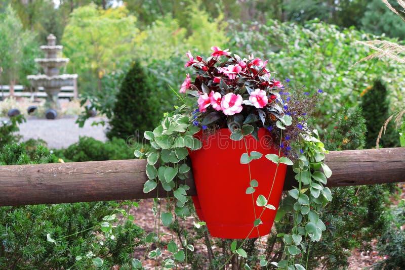 Cerca With Flower Pot foto de archivo libre de regalías