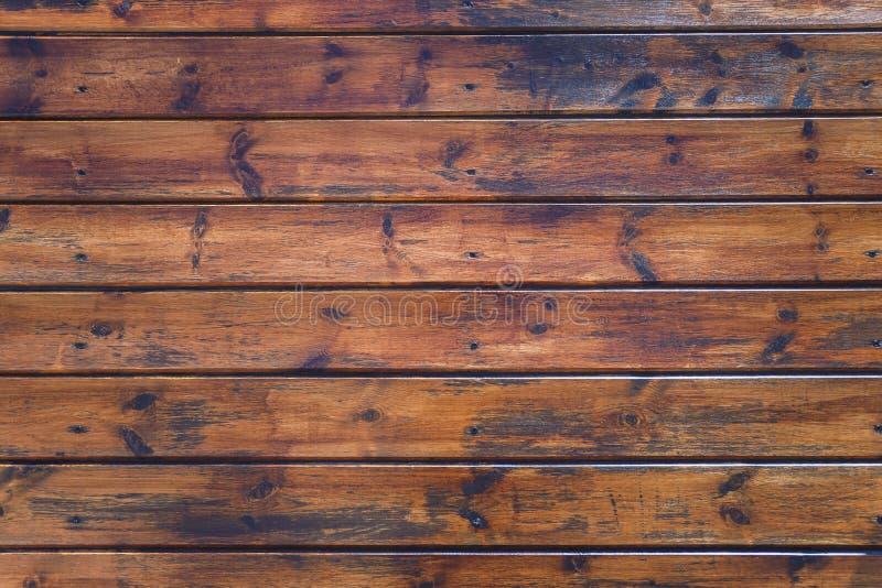 A cerca ou a parede de madeira atada resistida marrom resistida da prancha do vintage velho, fecham-se acima foto de stock