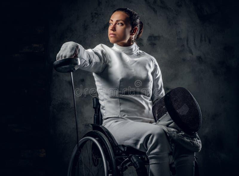 Cercador paralympic de sexo femenino de la silla de ruedas fotografía de archivo libre de regalías