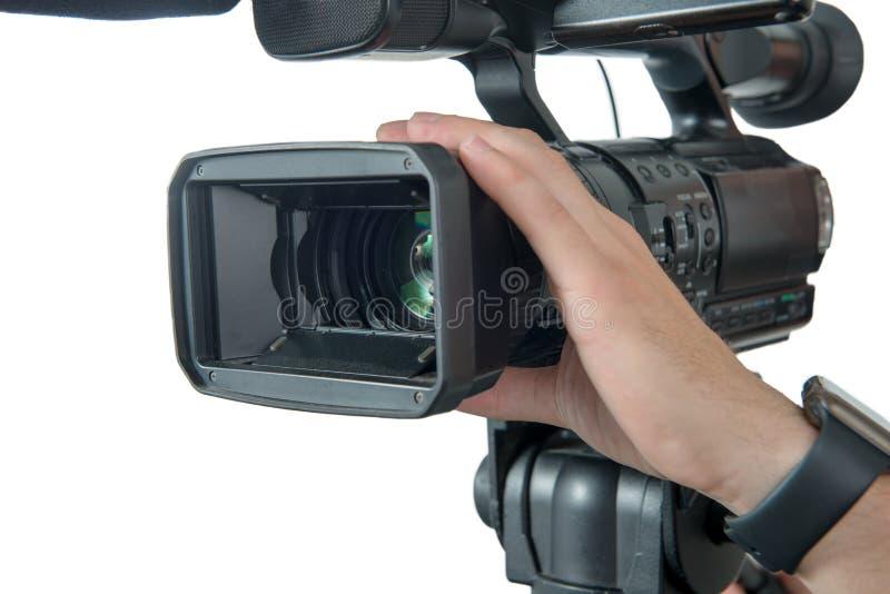 cercano para arriba de la mano del cameraman aislada en un fondo blanco imágenes de archivo libres de regalías