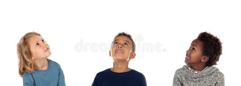 Cercare felice di tre bambini immagine stock