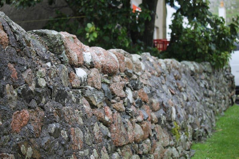 Cercas do muro de pedra na Escócia imagem de stock