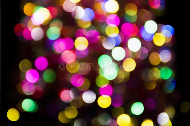 Cerchi festivi vaghi variopinti multicolori del bokeh immagine stock libera da diritti