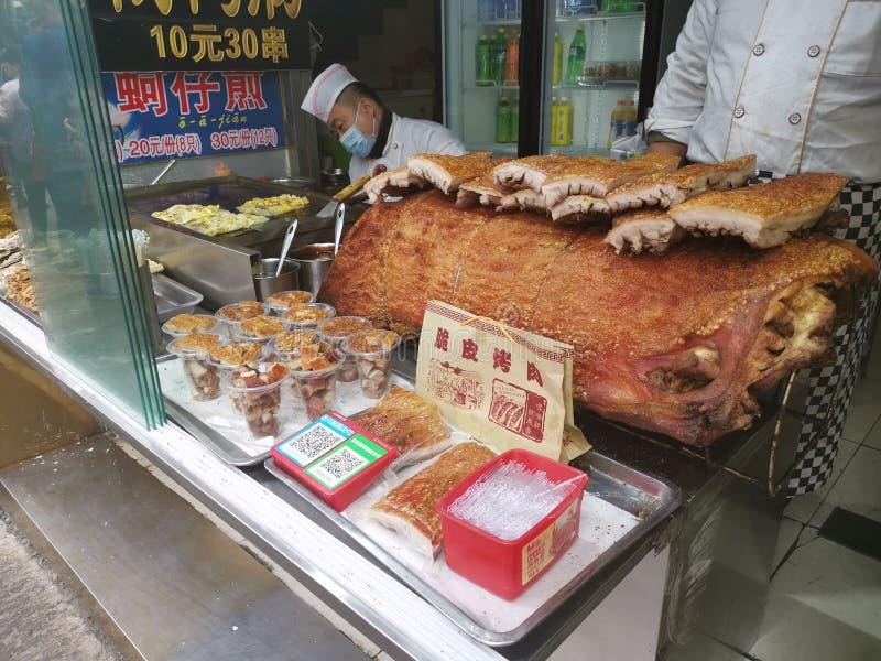 Cerdo curruscante del Bbq - calle de Furong de la comida de la calle @, Jinan Shandong China fotografía de archivo