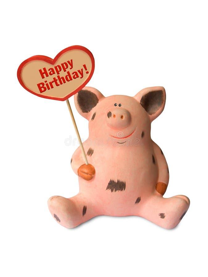 Cerdo divertido con feliz cumpleaños del corazón imagenes de archivo