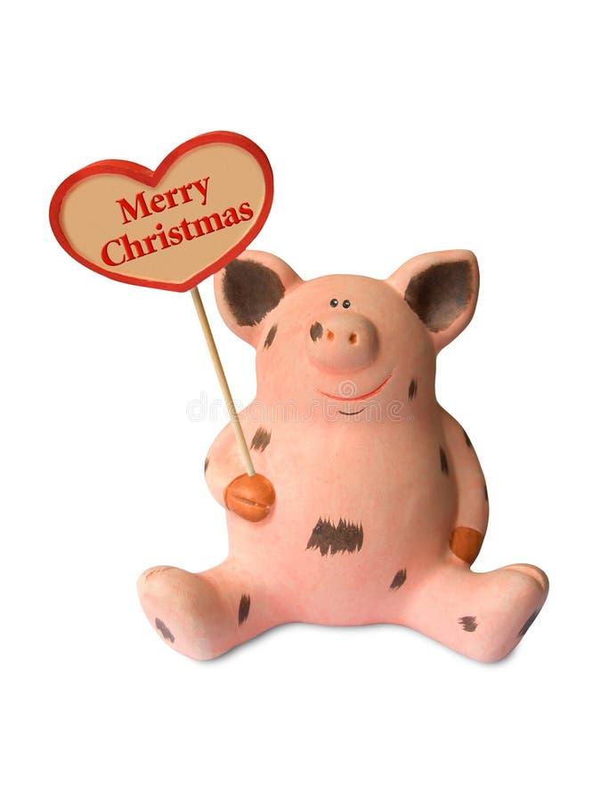Cerdo divertido con Feliz Navidad del corazón fotografía de archivo